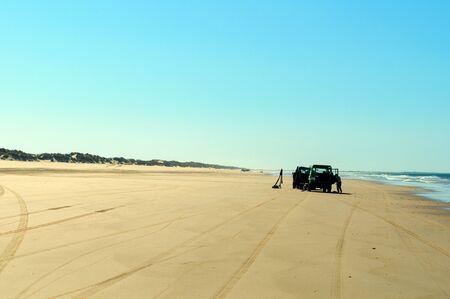 Beach shore with car wheel marks