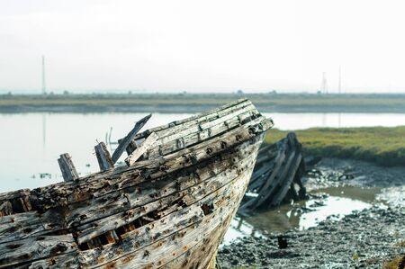 Bow of abandoned and broken wooden boat