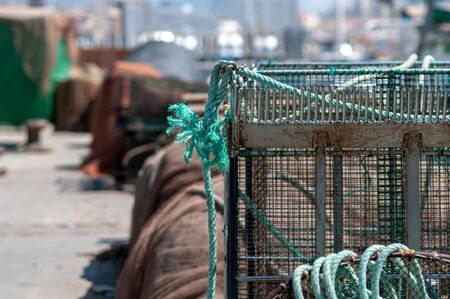Fishing traps attached with green rope