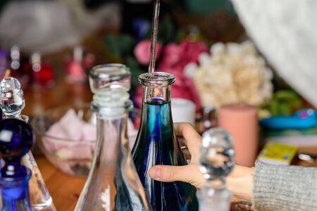 dropper and laboratory bottles in perfume shop Standard-Bild