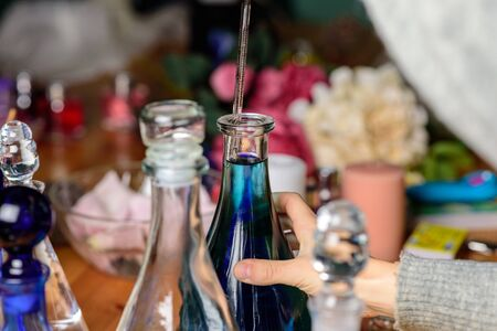 dropper and laboratory bottles in perfume shop Stock Photo