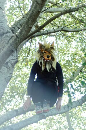 Woman in wolf mask and black dress