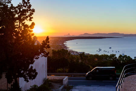 Beautiful Spanish beach sunset landscape with blue sea and mountains Foto de archivo