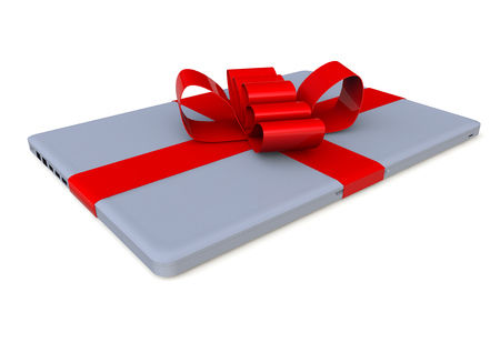 a laptop packaged as a gift with a red lopp
