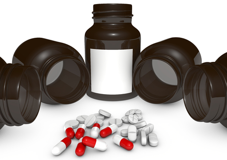 medication bottles with some red and white pills before Stock Photo