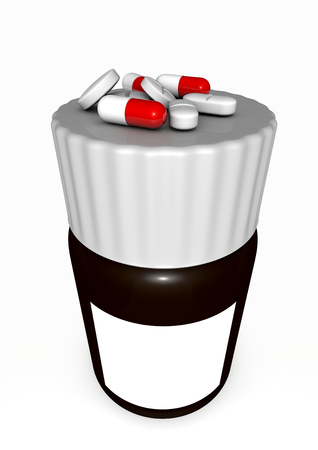 isoliert: medication bottle with some pills on the lid