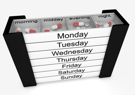 isoliert: pillbox with pills for every day in the week in english language Stock Photo