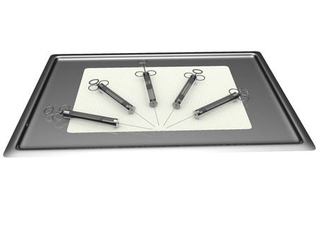 some different syringes on a metallic tray photo