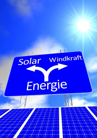 solarpower: a blue sky with the sun and a street sign with the directions in german lettering solarpower or windpower and solar panel Stock Photo