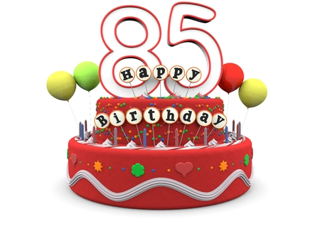 A birthday cream pie with balloons, big age number 85 and the lettering Happy Birthday on small sticks photo