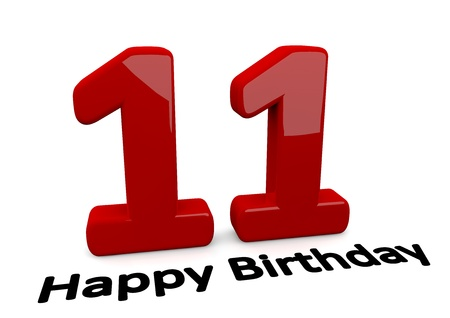 11 number: black lettering Happy Birthday on floor in front of a big red number 11 with reflection