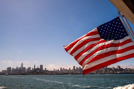 waving us flag in san francisco bay