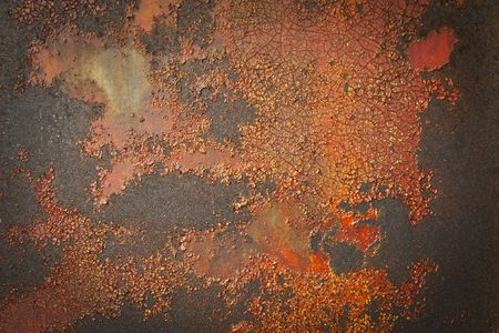 scuffed: Cracked paint on a rusted metal surface