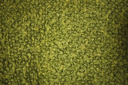 A green wool blanket knitted with fuzzy yarn Фото со стока