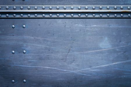 Rivets on scratched metal with seams