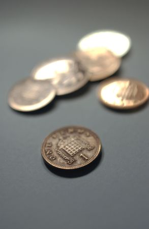 coinage: Copper coloured coinage on a grey background