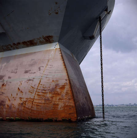 plating: Rusty steel plating on a ships bulbous bow. Stock Photo