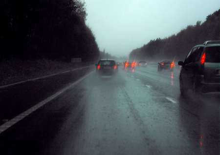motorway: Driving on rain soaked motorway with red lights Stock Photo