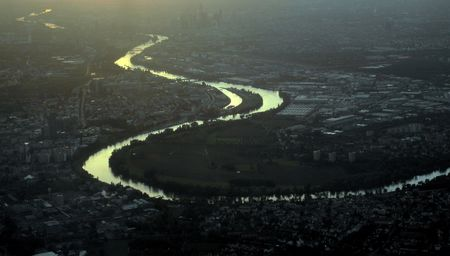 lifeblood: Aerial view of the river Rhine skirting the suburbs of city of Frankfurt in Germany Stock Photo