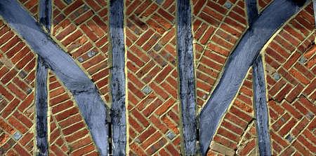 redbrick: Red bricks and mortar and the wooden framework of a Tudor era building