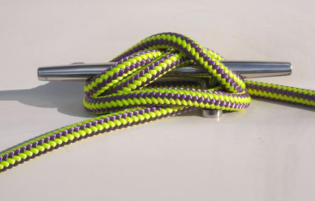 cleat: A cleat made up with multicoloured purple and yellow rope