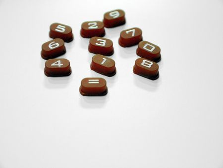 kaleidascope: Kaleidascope selection of numbers on plastic buttons Stock Photo