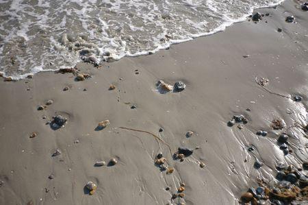 wavelet: Wavelet surfing onto sandy beach Stock Photo