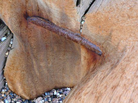 groyne: Eroded Groyne timber connecting bolt Stock Photo