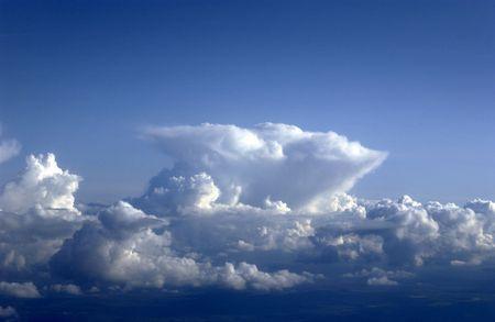 nimbus: Cumulo nimbus cloud building into typical anvil shape.