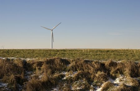 prevailing: Wind turbine in a cold northern agricultural French landscape.