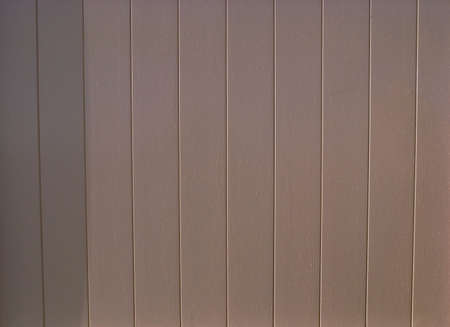 sheathing: Painted tongue and groove timber planks or clapboard sheathing material. Stock Photo