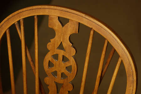 english oak: The back of an antique English light oak wooden willow back chair. Stock Photo