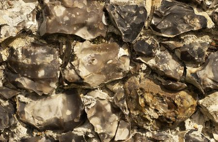 flint: Section of an old English split flint stone wall. Stock Photo