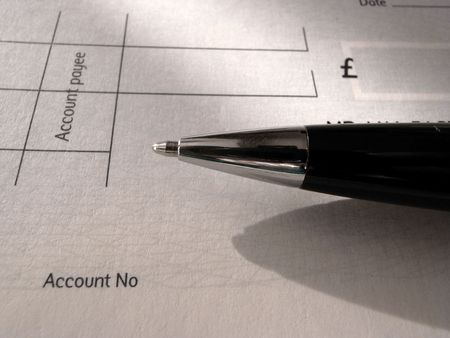 payee: Black and chrome biro pen and blank cheque.