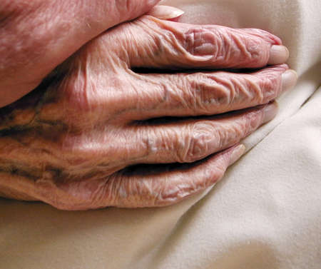 death and dying: The wrinkled skin of a very old age hand.