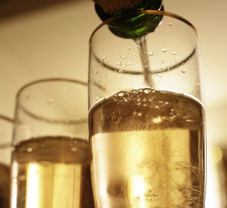 champers: Pouring French sparkling bubbly white wine into glasses.