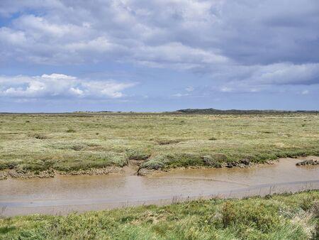 Muddy Mow Creek, Creek & Scott Head Island Nature Reserve mud flats on the North Norfolk Coast.