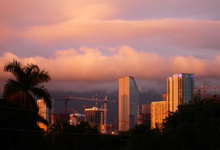 Downtown Miami skyline with cloud bands of approaching storm.