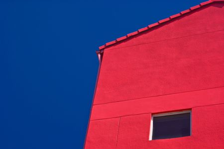 Red Building With One Window Against Cloudless Blue Sky