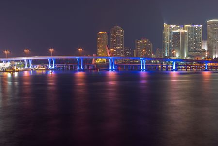 Downtown Miami Bayfront Skyline at Night, Showing Business, Residential and Entertainment Districts and Illuminated Bridge from Mainland to Port photo