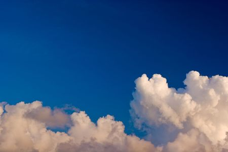 Blue Sky Over Layer of Puffy White Clouds