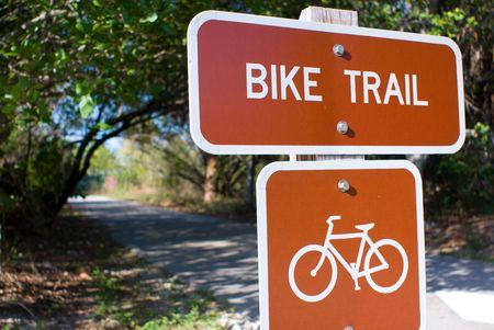 Bike trail sign at trail entrance. Stok Fotoğraf