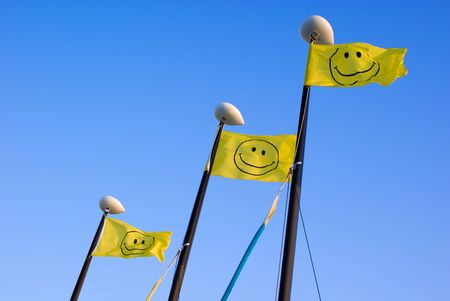 Smiley Face Flags on Boat Masts