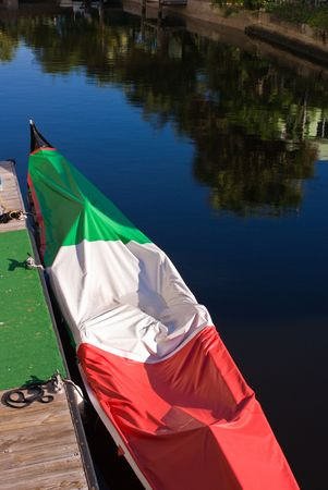 Tricolor Gondola Docked in Canal