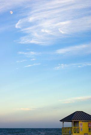 Moon Over Beach Hut and Peaceful Ocean