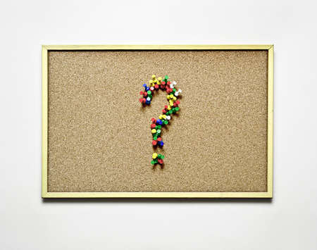 drawing pins: Question mark on a pin board made from drawing pins
