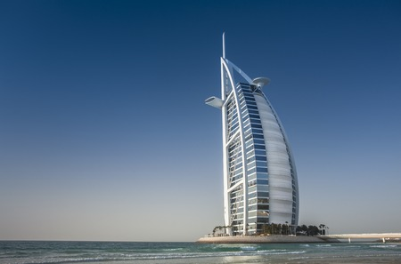 Burj Al Arab, Tower of the Arabs, is a luxury hotel located in Dubai, United Arab Emirates. Burj Al Arab stands on an artificial island out from Jumeirah beach, and is connected to the mainland by a private curving bridge.