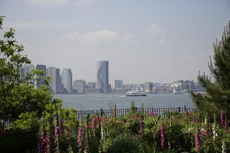 New york - Manhattan, view of Jersey city from battery park in the garden Stock Photo - 82388449