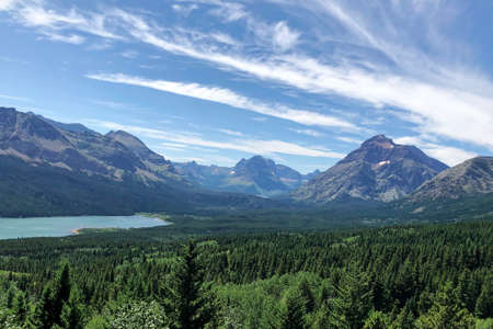 The mountains of Glacier National Park on a sunny summer day