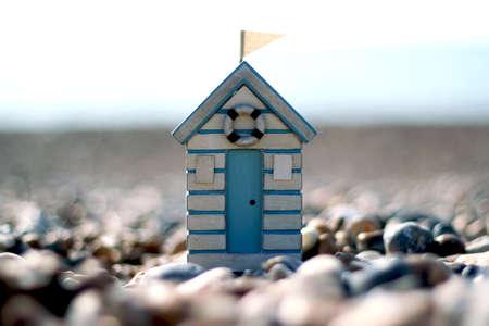 beach hut: Wooden toy beach hut on a pebble beach Stock Photo